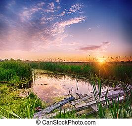 Rural summer sunrise landscape with river, wooden bridge and...