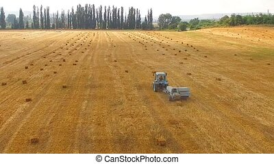 Rural Tractor Baler Standing In Stubble Yellow Field - This...