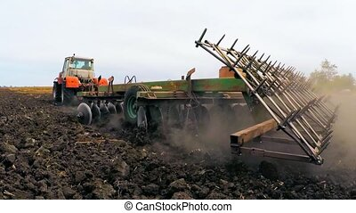 Rural Tractor Trailer Cultivating Soil Of Agricultural Field...