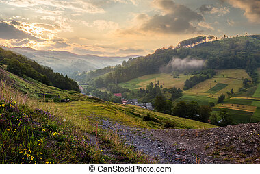 rural valley with forested hills at sunrise. beautiful...