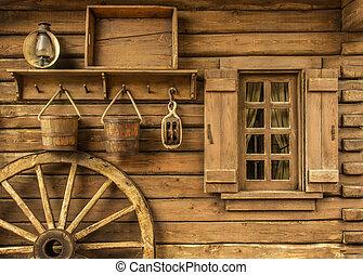 Rural Wertern - Detail of old wagon wheel next to a wooden...