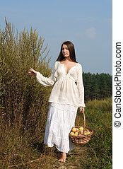 Rural women's portrait with basket of apples