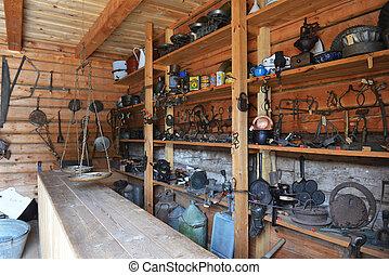 rural work tools, hung on  walls of  barn