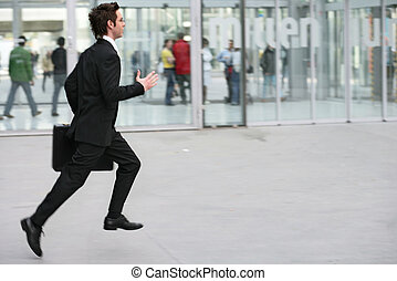 businessman running with his executive case