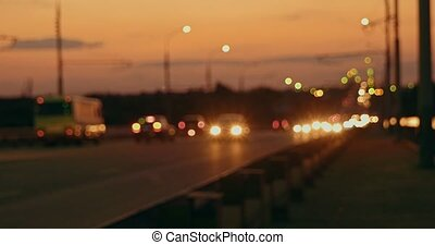 Rush hour on freeway in the night, blured lights of...