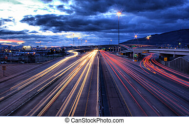 This is a view ofthe junction of I-10 and I-54, in El Paso, Texas. In the spagetthi bowl to the middle and right of the frame is I-54; which the highway to take into the primarry entrance of Fort Bliss. In the back you could appreciate the star in the mountain, now a city icon. It was originally ...