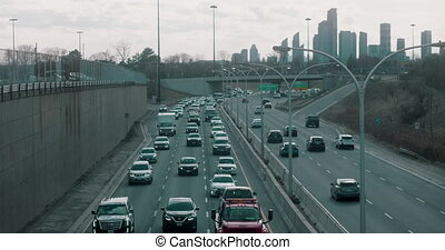 Rush hour traffic in Downtown Toronto. 4K Establishing shot.
