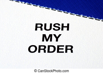 """""""Rush My Order"""" from a business reply postcard isolated on blue"""