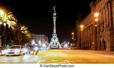 rush of night time traffic at colon, barcelona, spain