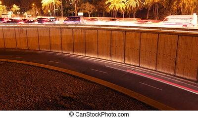rush of night time traffic on motorway in timelapse scene,...