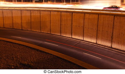 rush of night time traffic on motorway in timelapse scene, barcelona, spain