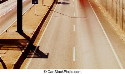 rush of traffic on motorway in timelapse scene, barcelona,...