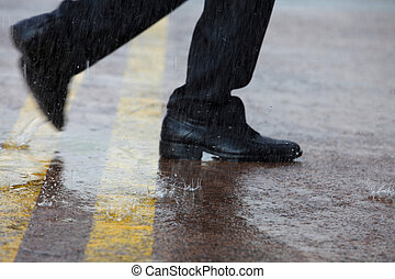 close up of man running in the rain