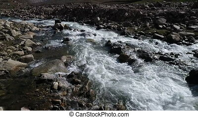 Rushing river water through mountain landscape. - Medium...