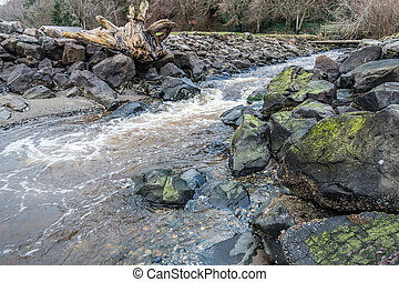 Rushing Stream And Rocks 2 - A stream rushes past rocks on ...