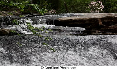 Water rushing over natural rock formation