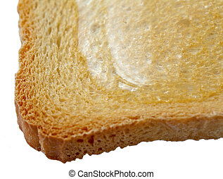Rusk with honey, isolated over white, selective focus