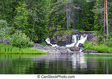 Ruskeala Waterfalls in the forest under a blue sky with clouds, Karelia. Russia