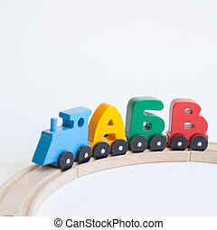ruso, de madera, cartas, tren, alfabeto, con, locomotive., colores brillantes, de, amarillo rojo, verde y azul, en, un, blanco, fondo., niñez temprana, educación, aprender leer, preescolar, y, juego niños, concept.