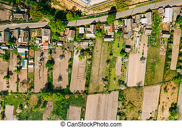 Russia. Aerial View Of Small Town, Village Cityscape Skyline In Summer Day. Residential District, Houses And Vegetable Garden Beds In Bird's-eye View