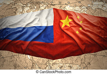 Russia and China - Russian and Chinese flags on the...