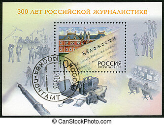 RUSSIA - CIRCA 2003: A stamp printed in Russia dedicated the 300th anniversary of the Russian journalism,circa 2003