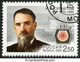 RUSSIA - CIRCA 2003: A stamp printed in Russia dedicated the 100th birth anniversary of I.V.Kurchatov (1903-1960), a physicist, circa 2003