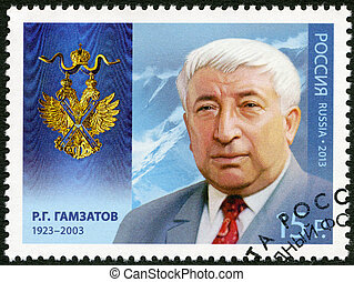 RUSSIA - CIRCA 2013: A stamp printed in Russia shows Rasul Gamzatovich Gamzatov (1923-2003), series Holders of the Order of Saint Andrew the First-Called, circa 2013