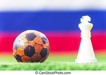 Russia Flag Chess as a football. FIFA World Cup 2018.Ball and white figure on the green grass.