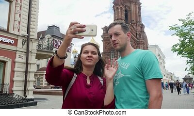 Russia, Kazan, 15 june 2017. Young couple taking a selfie on a mobile phone. 3840x2160