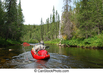 Canoe on the river in the virgin forests of Komi.