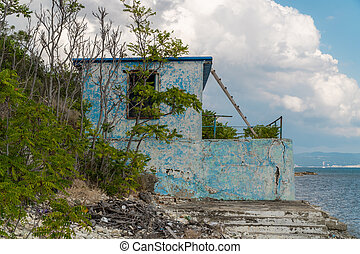 Black sea coast in the area of the Thin Cape of the city of Gelendzhik. Photo of an abandoned rescue station.