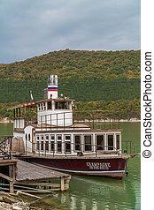 Russia. Krasnodar region. Pleasure boat Champagne on the picturesque lake Abrau in the vicinity of Novorossiysk.