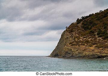 Rocky black sea coast in the vicinity of lake Abrau near Novorossiysk.