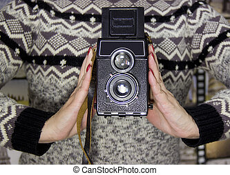 vintage camera in the hands of a girl