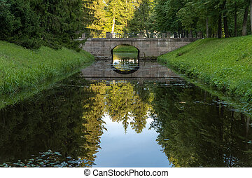 Stone historical bridge over the canal in Oranienbaum Lomonosov Park.