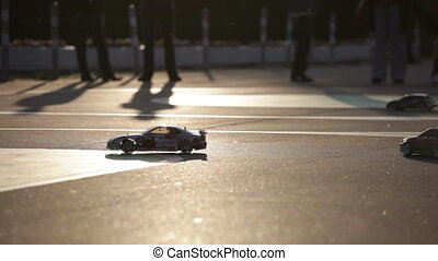 RUSSIA, MOSCOW - JULY 25,2014:Toy racing machines ride on...