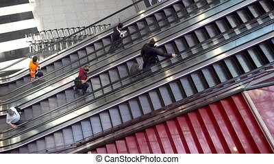 RUSSIA, MOSCOW, SVO - April 25, 2019: People on escalators....