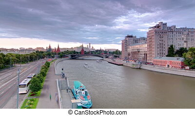 Russia. Moscow. View from the Patriarchal Bridge towards the Moscow Kremlin and The Large Stone Bridge day to night timelapse.