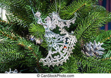 Christmas tree decoration in the form of a transparent glowing angel.