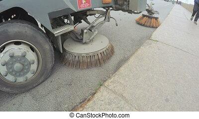 Sweeper machine on street