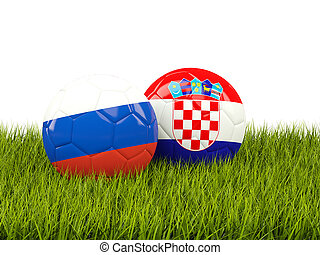 Russia vs Croatia. Soccer concept. Footballs with flags on green grass