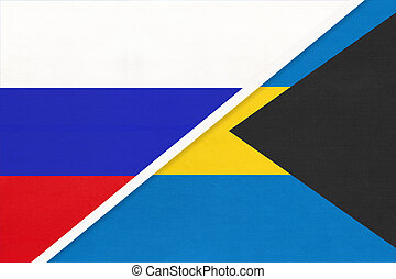 Russia vs The Bahamas national flag from textile. Relationship and partnership between two countries.