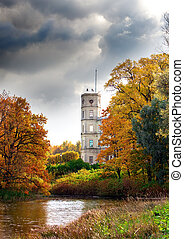Russia,Gatchina, bright autumn tree in park near a palace