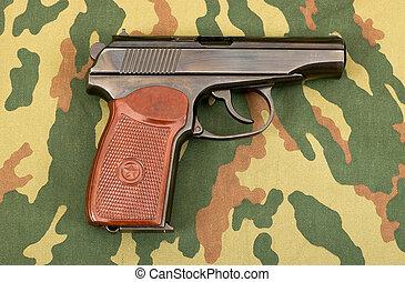 Russian 9mm handgun on camouflage background