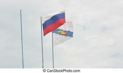 Russian and Yeisk flag, growing in the wind