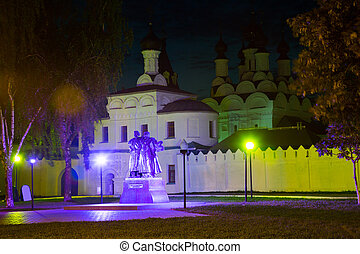 Night scene of illuminated russian orthodox annunciation friary buildings in Murom, Russia