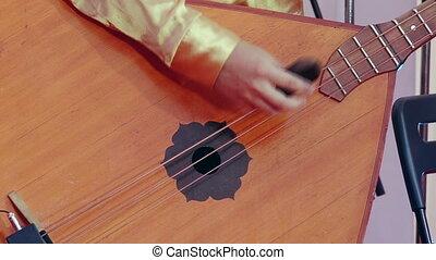 Russian artist playing balalaika, close up. - Artist playing...
