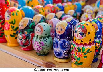 Russian Babushka Dolls - Colourful wooden nesting dolls from...