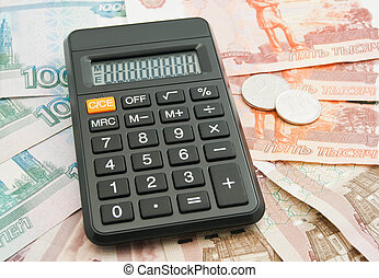 Russian banknotes, coins and calculator